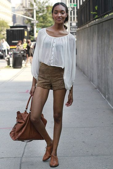 suede shorts and sheer blouse