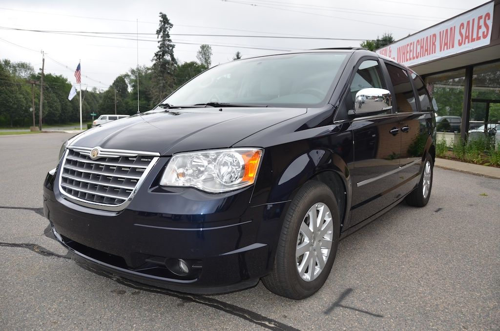 Front Left Side View Of The 2010 Chrysler Town And Country Touring