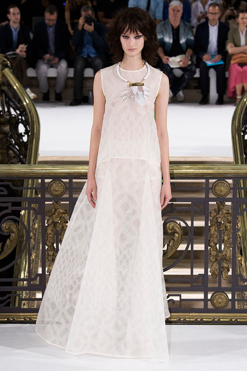 John Galliano - Its all about glamour, angles, and an architectural touch.
