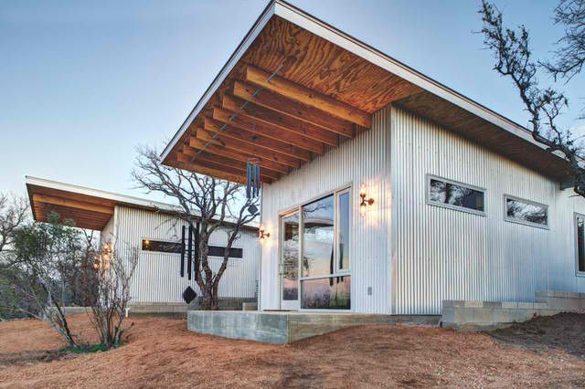 The Butterfly Roof Cantilevers 6 Feet Out Creating A Front Overhang The Corrugated Metal Exterior Small Modern Cabin Tiny House Community Tiny House Vacation