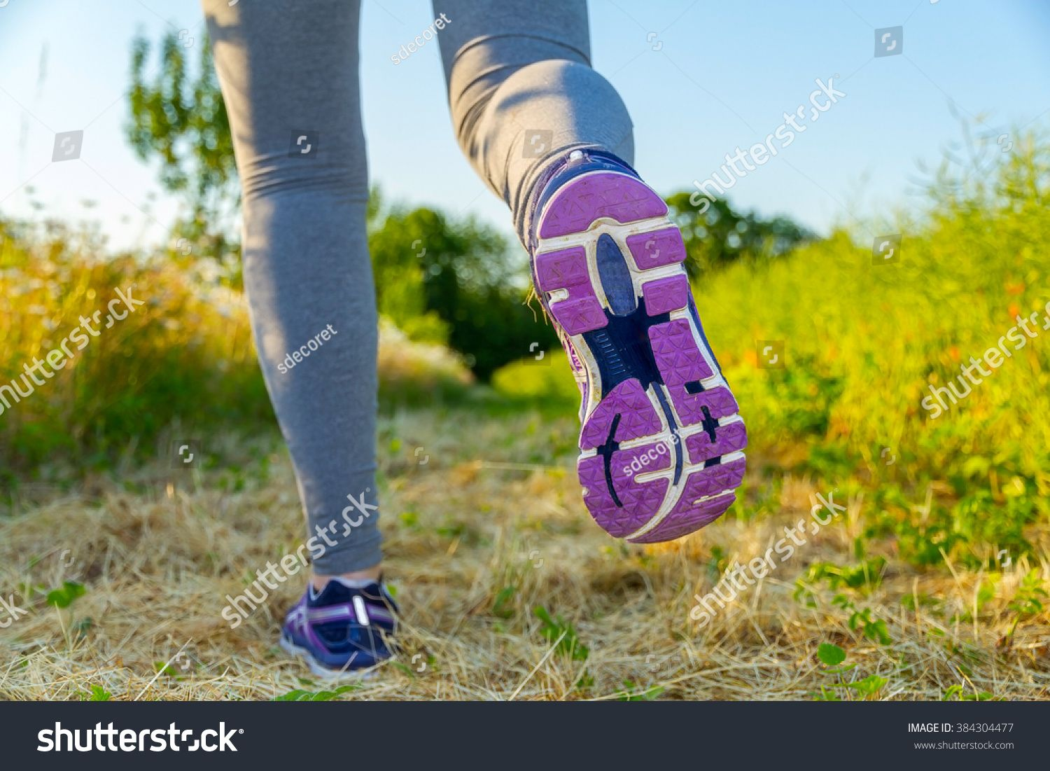 Fitness Girl running at sunset in a path surrounded by fields with colorful outfit #Ad , #SPONSORED,...
