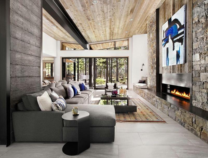 Mur en pierre - accent dans une maison rustique moderne | Salons