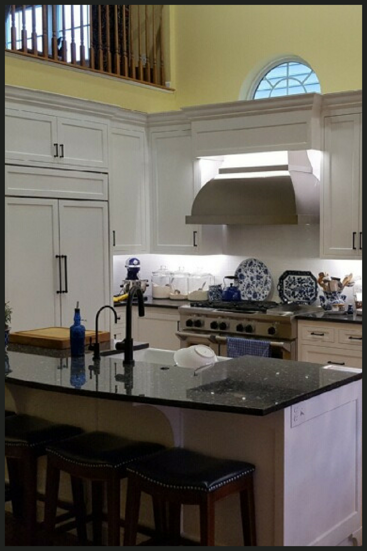 White flat panel painted kitchen cabinets with flush inset ...