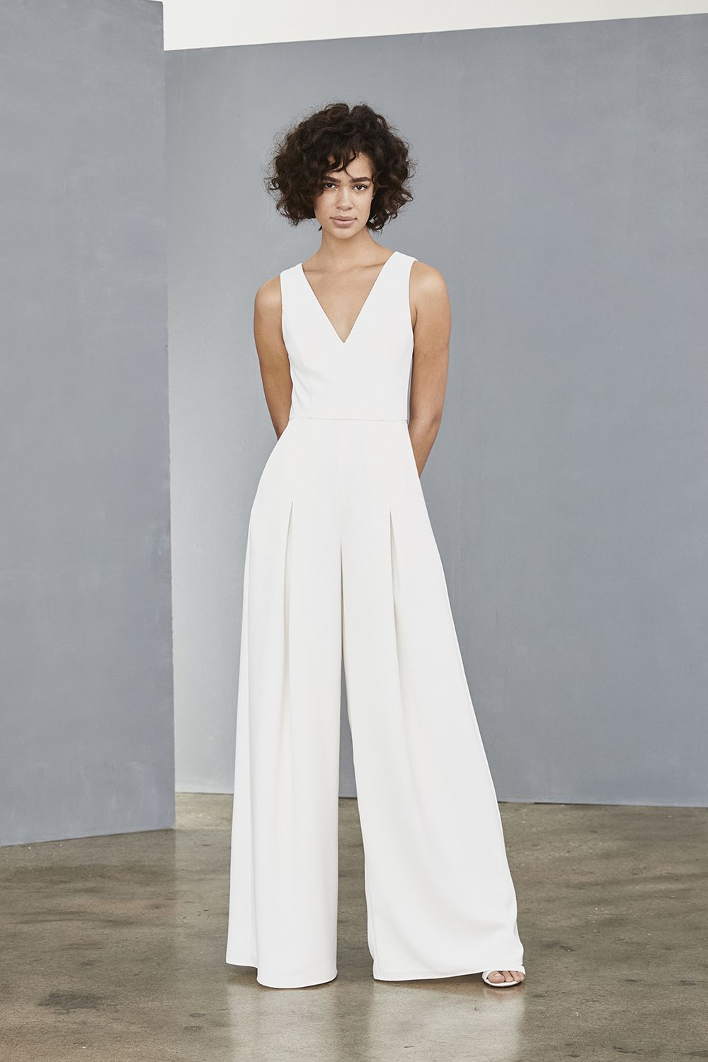 f4168ef1516f Crepe V neck jumpsuit with wide legs and sheer illusion back.