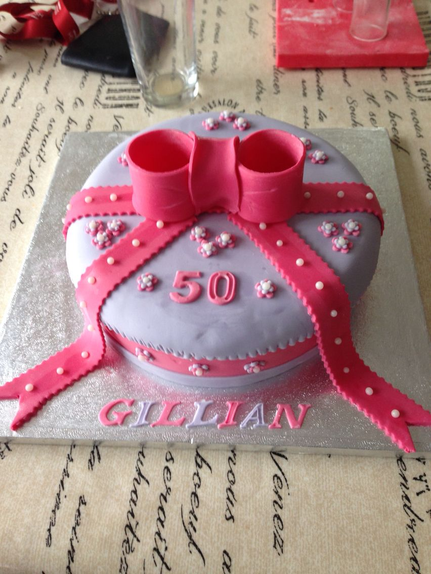 50th birthday cake with bow