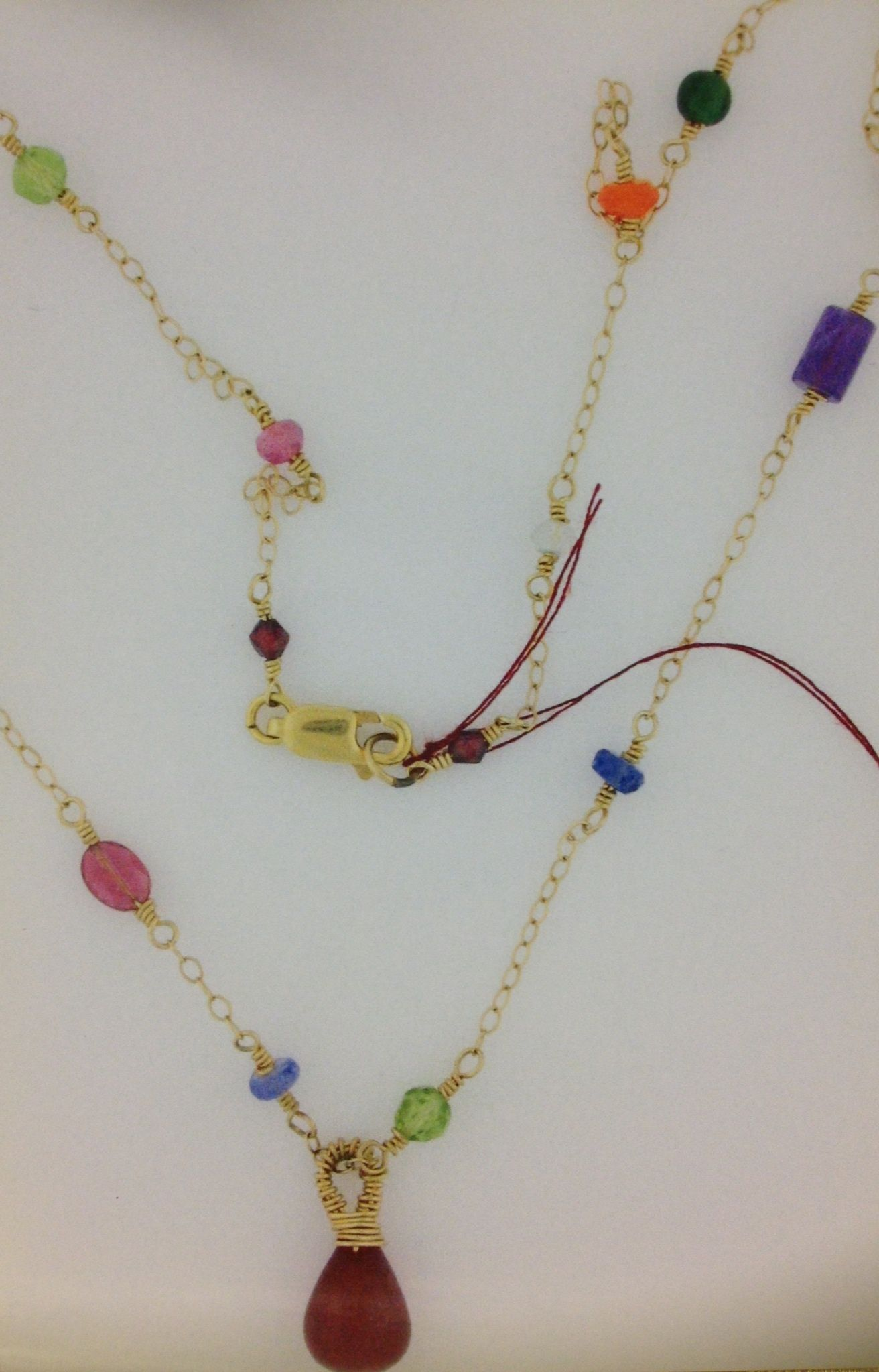 14k chain with wire wrapped semiprecious stones. Small ruby wire ...