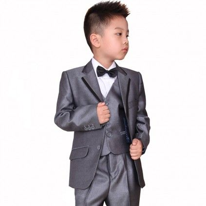 Shop online the fashionable and fabulous set of tuxedo for young baby boys in India. This is a handsome set of grey coat, pair of pants, vest, 1 tie and 2 bows which lets you dress your little kid in different styles for various parties and gatherings.