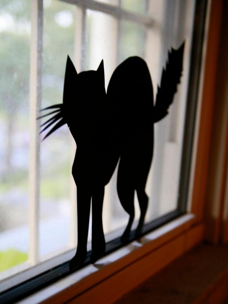 The window silhouettes in this post were lit using table lamps - Window Halloween Decorations