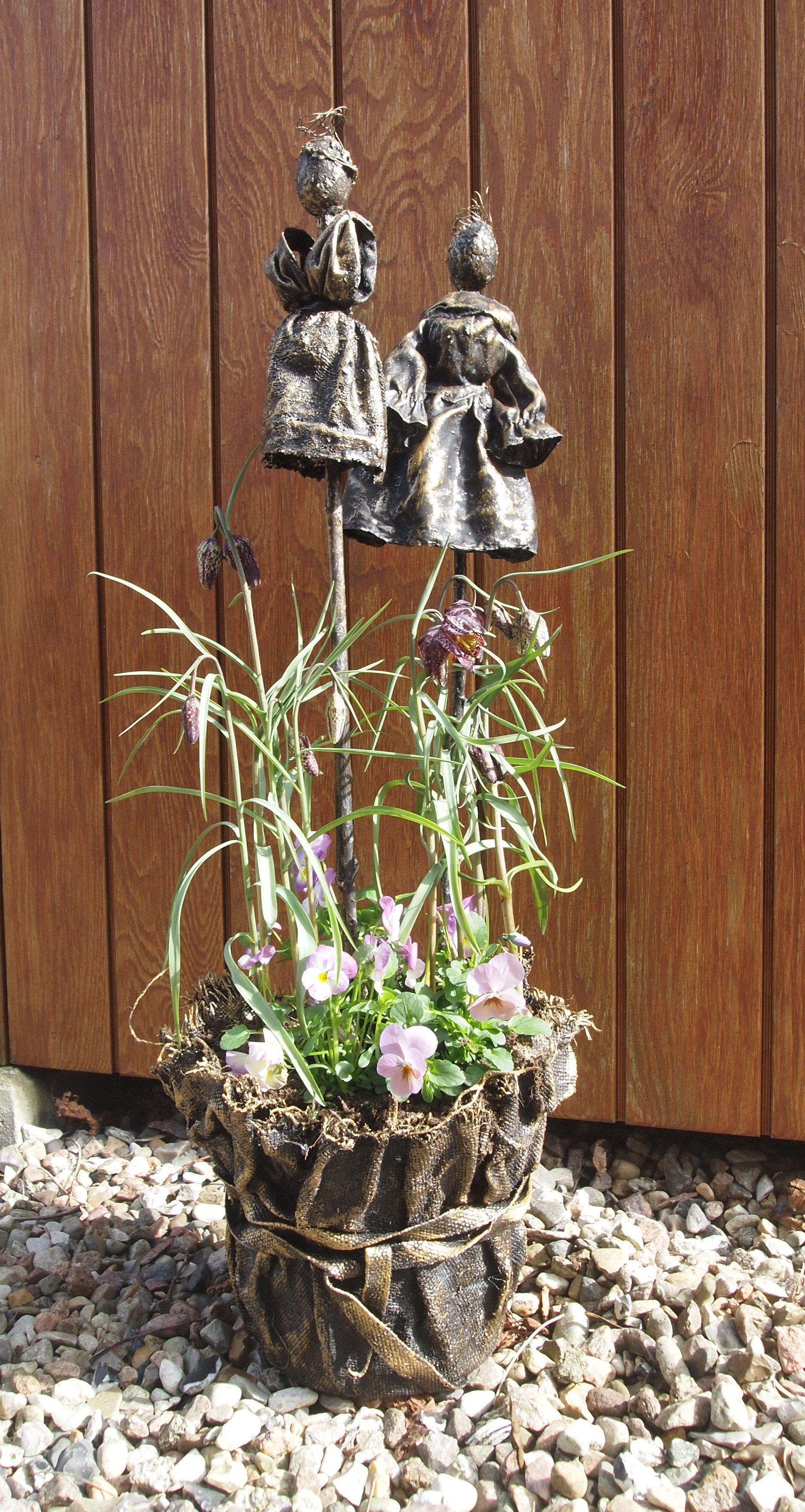 Recyclings krukke med blomsterpiger.
