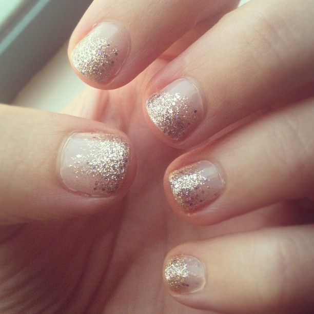 Gold glitter ombre tips over neutral nails. [Photo by ...