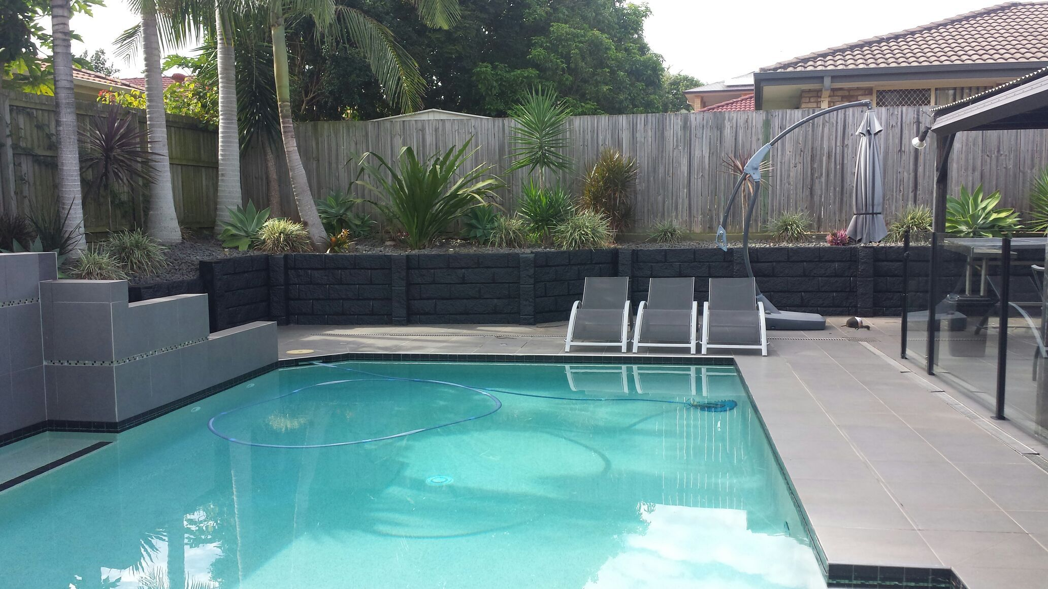 Sandstone Effect Concrete Sleepers Posts Sealed With Black Sealant Dream Backyard Dream Pools Backyard