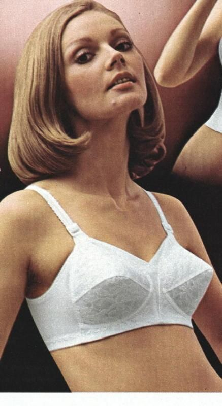 defca57f38a1a Love that 70 s hairstyle and the cone shape bra!