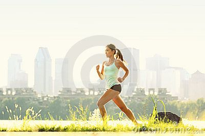 City fitness. Running in outdoor park. Woman runner outside jogging with Montreal skyline in background. #fitness #Woman