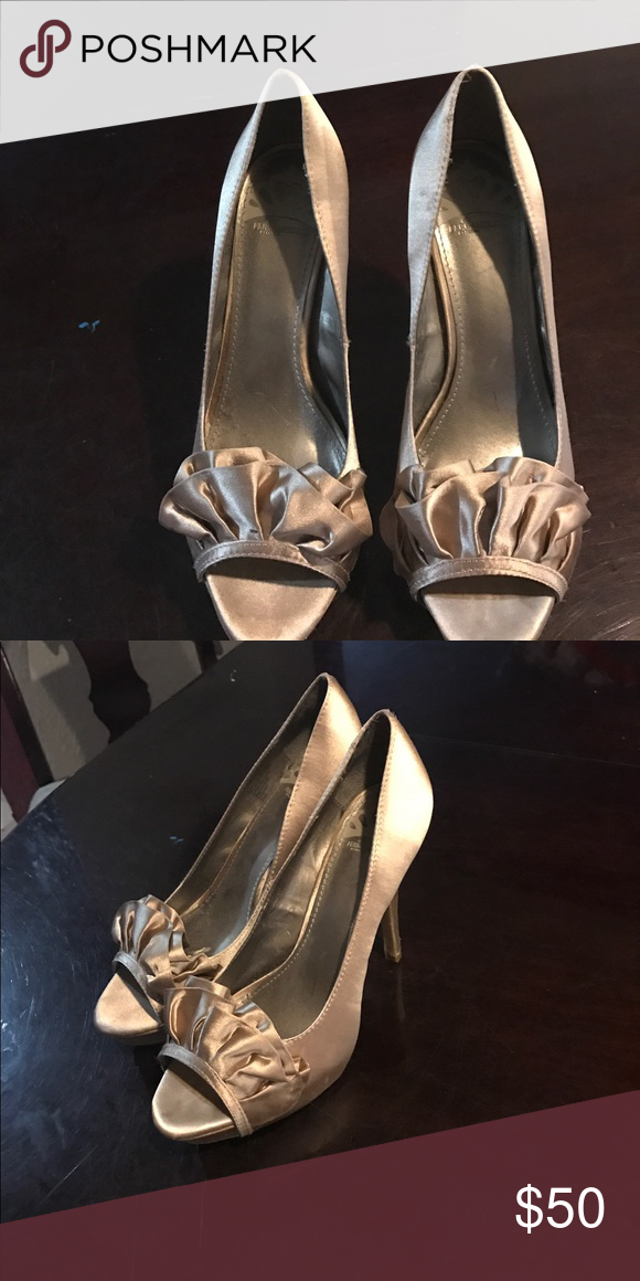 Satin Champagne Fergalicious heels Satin Champagne color pumps with a bow... Brand new never worn Fergalicious Shoes Heels