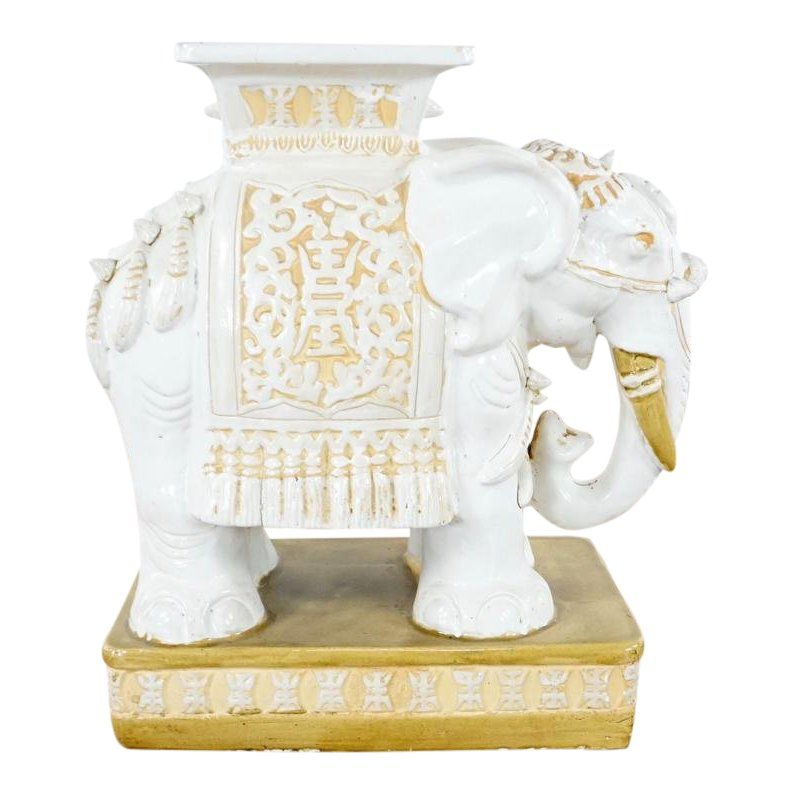 Contemporary gold and white painted ceramic elephant end