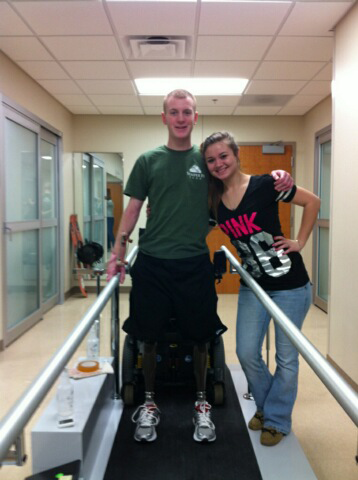 My brother stepped on a bomb in Afghanistan in November and lost both his legs... and is learning to walk!  That's Kyle with his wife, Alex.