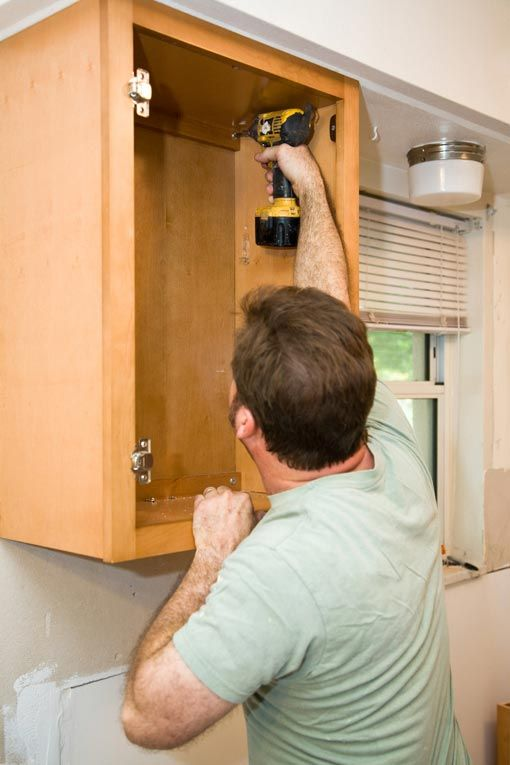 How To Install Kitchen Cabinets Hometips Installing Kitchen Cabinets Installing Cabinets Easy Woodworking Projects