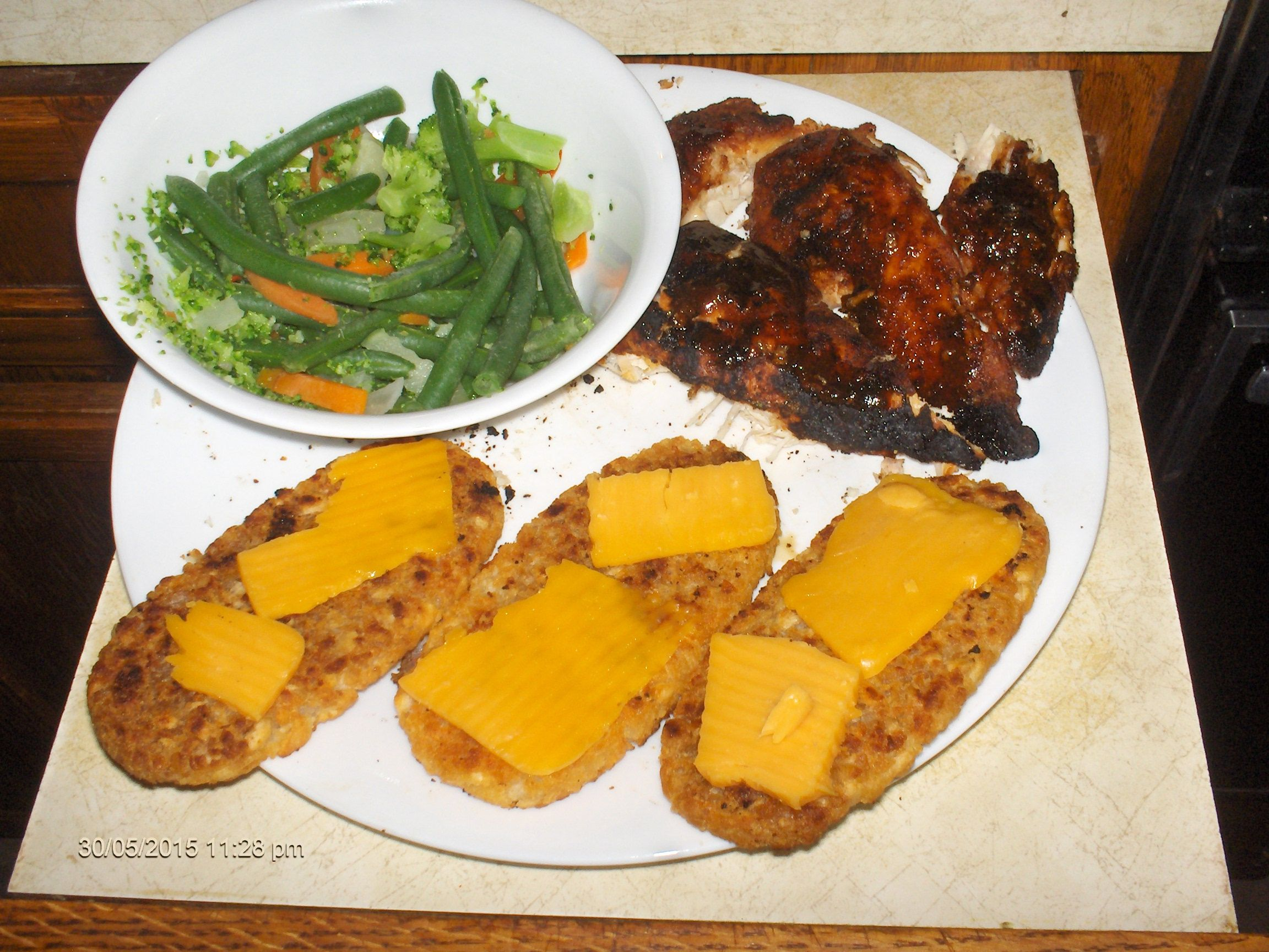 Smoked Montreal BBQ Chicken.... BBQ toasted tater Patties... Stir-fry vegetables... Need I say more???