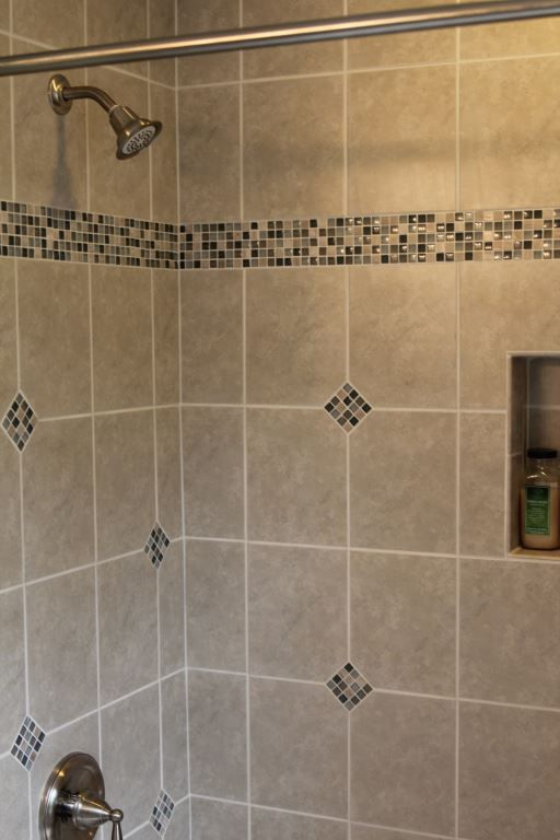 Avon Lake bathroom remodel featuring a new tiled shower with Kohler ...