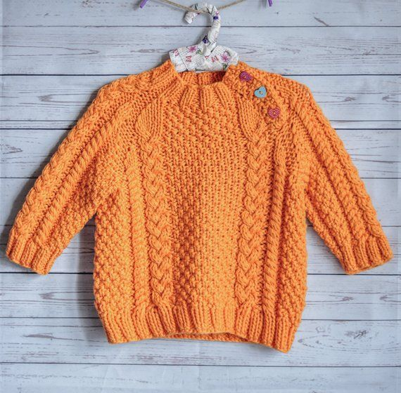 f3a374cb1 knitted little handmade sweater for baby orange color