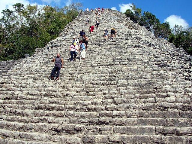 climbing Coba large Pyramid Mexican Mayan Ruins Tour