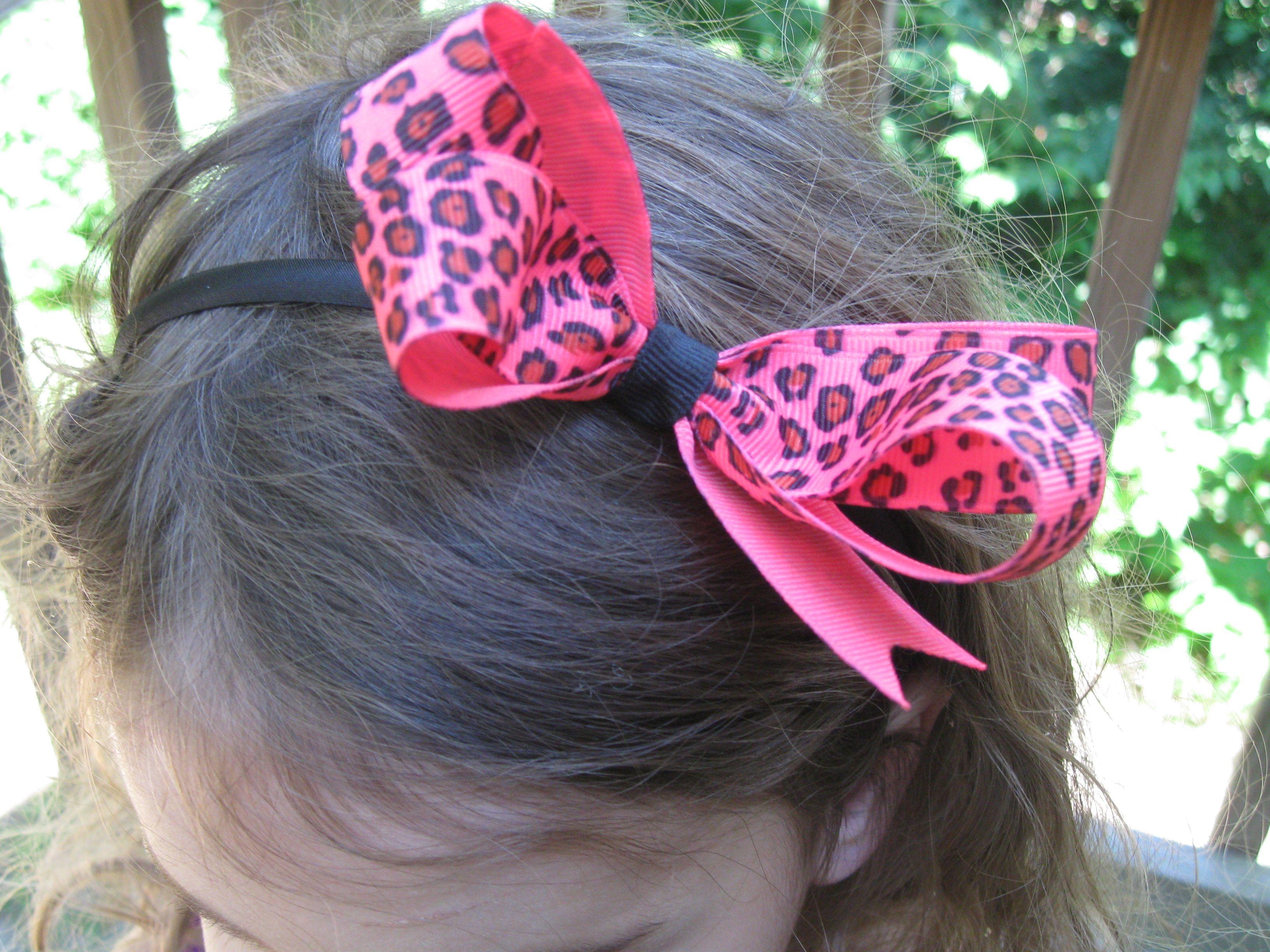 Neon pink cheetah bow on black headband by rulu ruludesigns