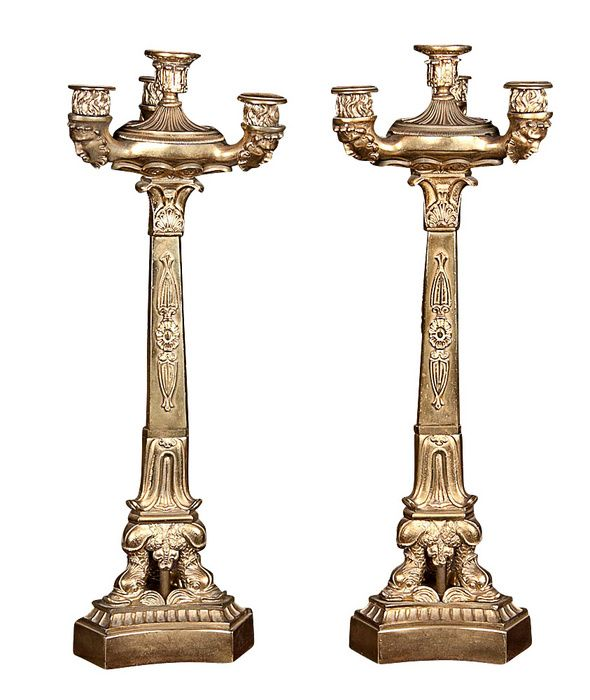 """A pair of French Empire, bronze, four-light candelabra with dolphin base and masks. CIRCA: 1810 DIMENSIONS: 22"""" h PRICE: $3,500"""