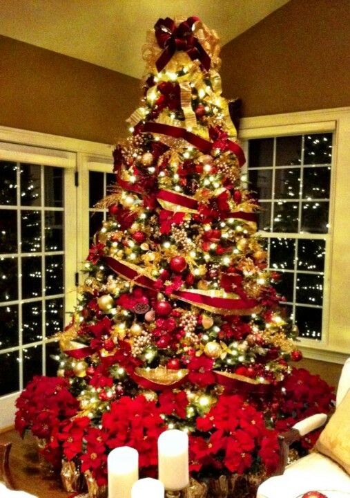 I Love The Christmas Plants Under The Tree Instead Of Gifts Gold Christmas Tree Decorations Red And Gold Christmas Tree Christmas Tree Decorations Diy