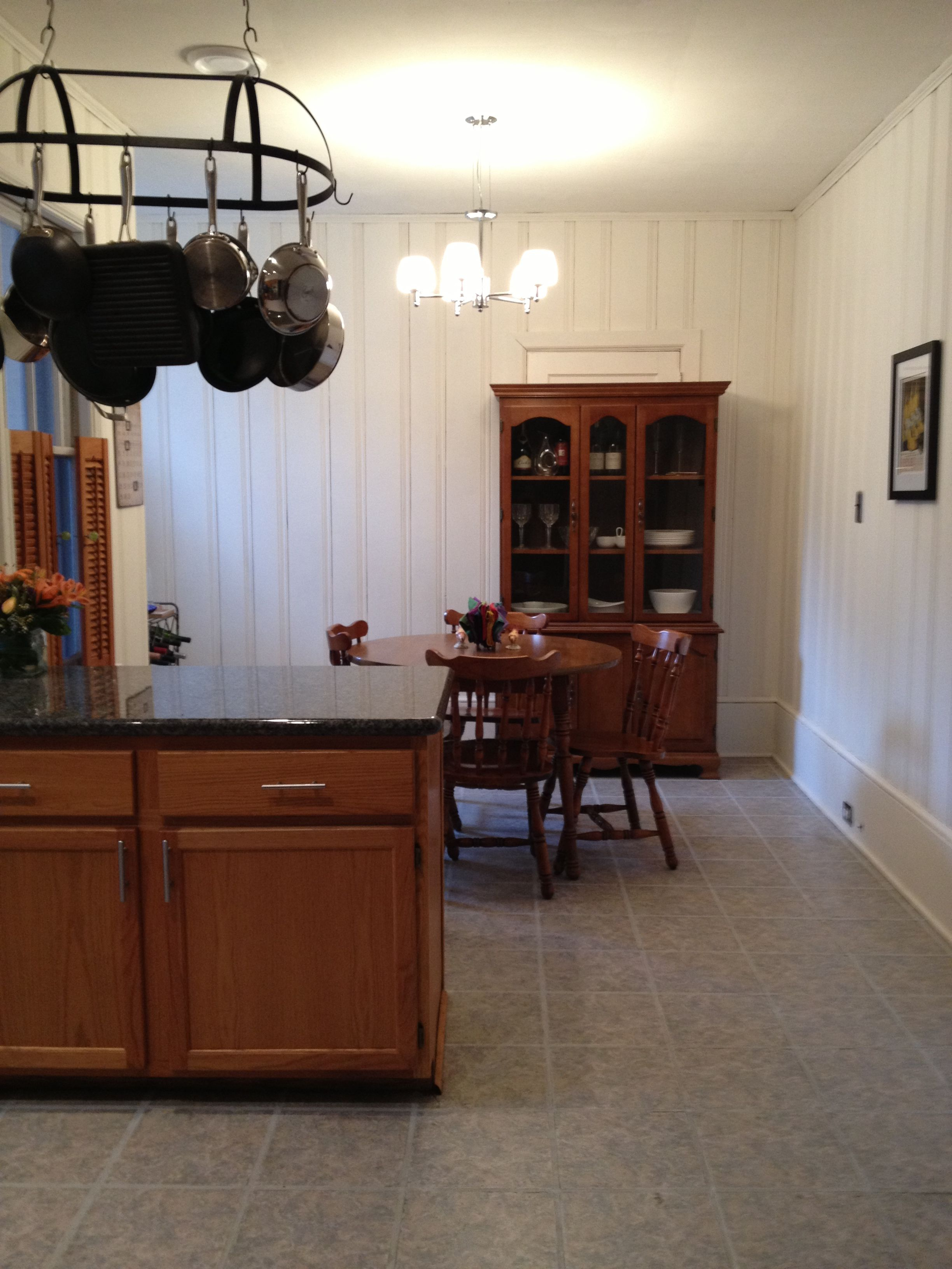 Painted Paneling, White Baseboards, And Linoleum Flooring To Brighten Up  The Kitchen.