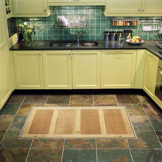 trapdoor in the kitchen floor: spiral wine cellars | trap door