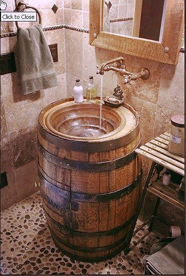 Unique Barrel sink within a bathroom. What a wonderful to upcycle a beautiful product. What else could you do with these barrels? #wine #barrels #whiskeybarrels #whiskey #home #decor #homedecor #bathroom #sink #DIY