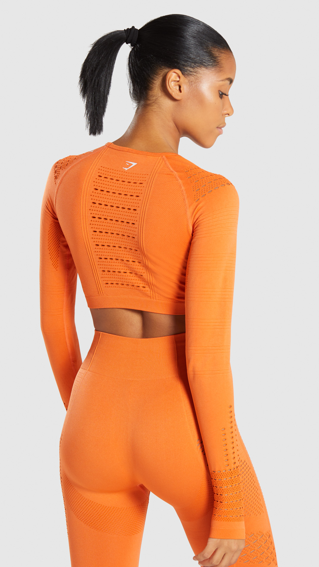 32222c0db7e1f The Flawless Knit Long Sleeve Crop Top, Burnt Orange. Settle for nothing  less than Flawless. A fitted design with midriff crop, eyelet and rib  patterns and ...