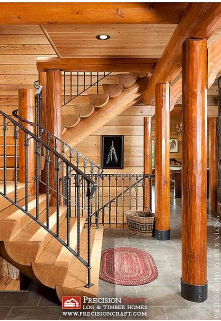 fun wrought iron staircase. Rug at the bottom of stairs  Cabin fun Pinterest