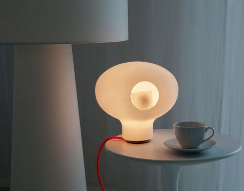 Quarch Atelier designed the C'est Chouette lamp that might be the cutest thing we've ever seen. Inspired by fairy tales, the owl sits inside the outer globe as if to sit in a nest.
