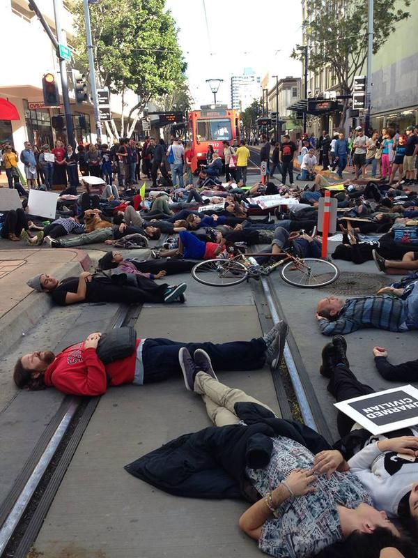 A die-in on the trolley tracks downtown. Photo via UAPTSD