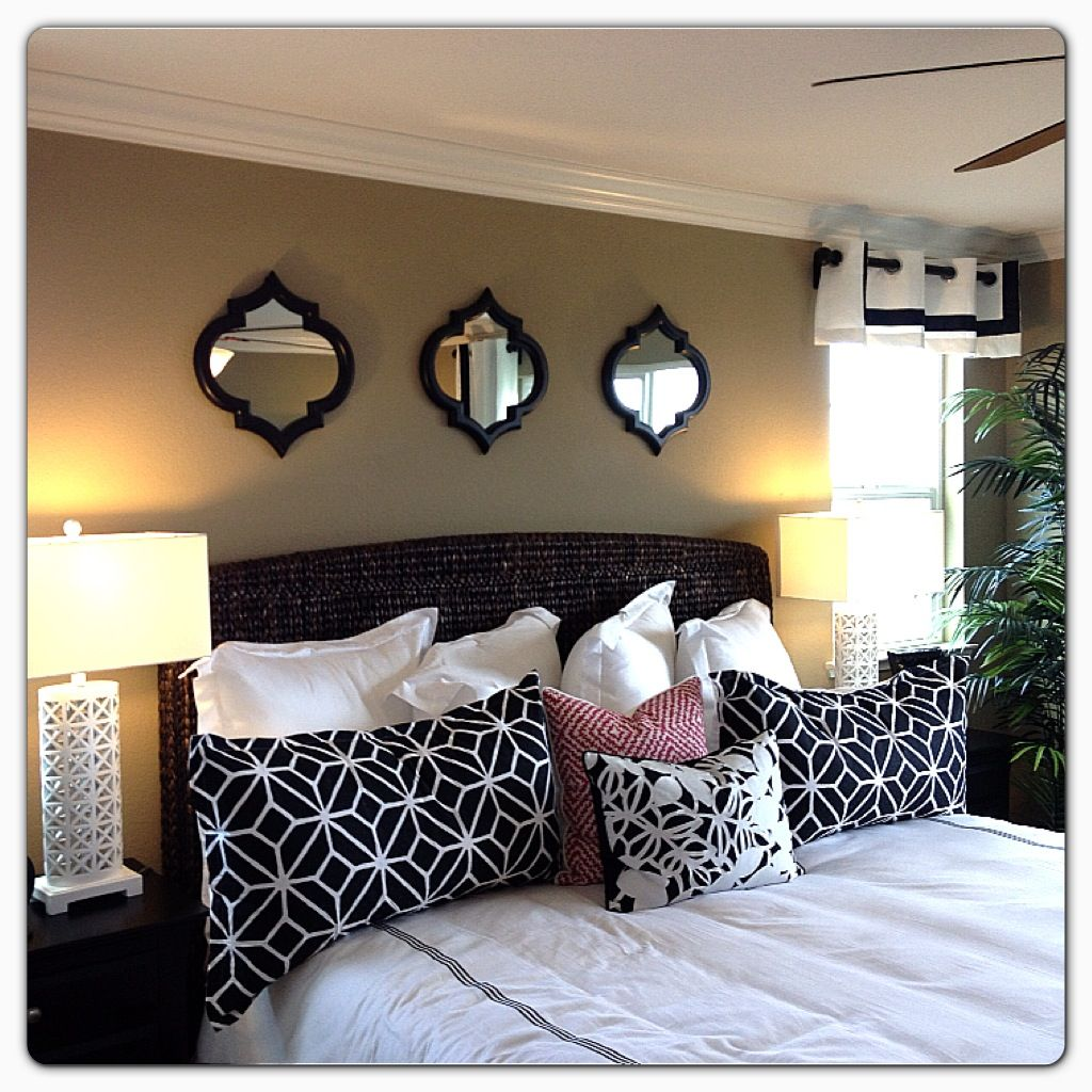 LOVE those mirrors above the bed. nice and simple Home