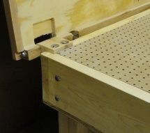Add a sanding table to an assembly table with hinged top for when not in use