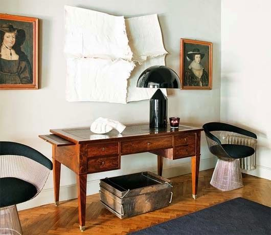 Amazing combination of traditional portraits and modern paper art in this home office.