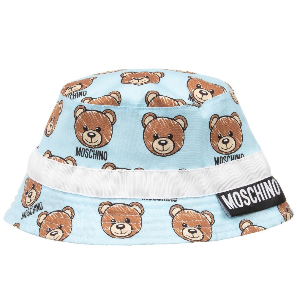 936963de0ad Unisex cotton poplin baby sun hat from Moschino Baby. The light blue fabric  has a teddy print