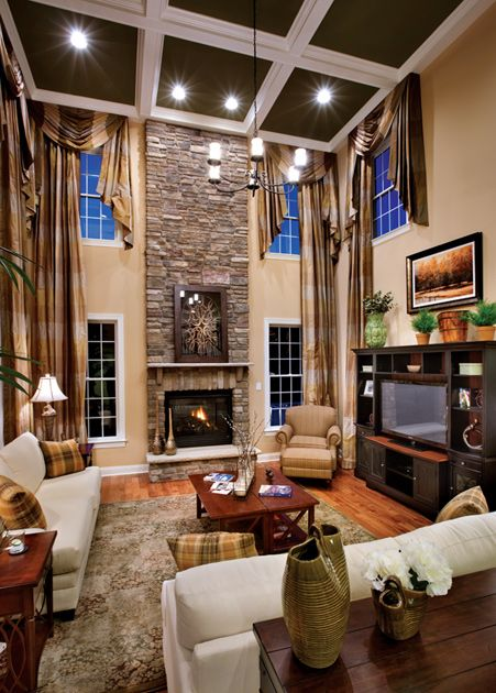 2 story family room with coffered ceiling and