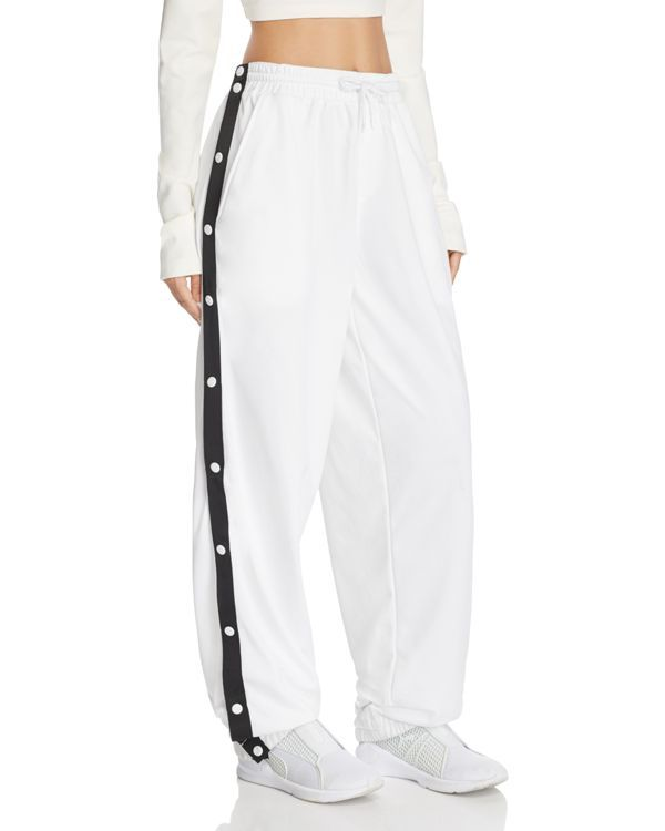 e53f2170274e Rihanna throws it back to track for her signature Fenty Puma collection  with this sporty pair of tear-away pants. Featuring snap-close sides and an  ...