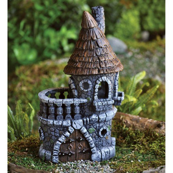 Fairy Garden  Mini  Fairy Castle  Miniature Supplies Accessories Dollhouse is part of Fairy garden Castle - What is a fairy garden without a fairy castle  This lovely stone castle is tidy and compact, featuring a tower with witches hat styled rooftop adorned in old wooden shingles, lots of round and arched windows, and a balcony framed in elaborate stone columns  The double wooden doors feature heavy duty iron work and there is even a Juliet balcony for stargazing or watching for invading trolls  On its own or as part of a larger village, it has a tremendous amount of detail and visual appeal Dimensions 4 25  Wide x 3 25  Deep x 8 5  HighMaterial Resin
