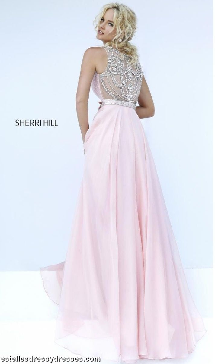 This Sherri Hill prom dress 11320 showcases a high illusion neckline, beaded  sweetheart bodice, and flowing chiffon skirt.
