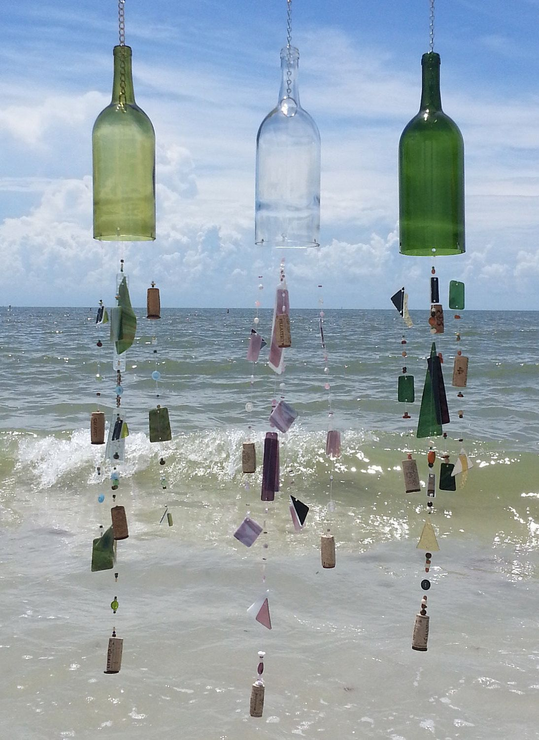 Ornamental bottles - Modified Wine Bottles When Strung With Beautiful Pieces Of Glass Make Ornamental Wind Chimes