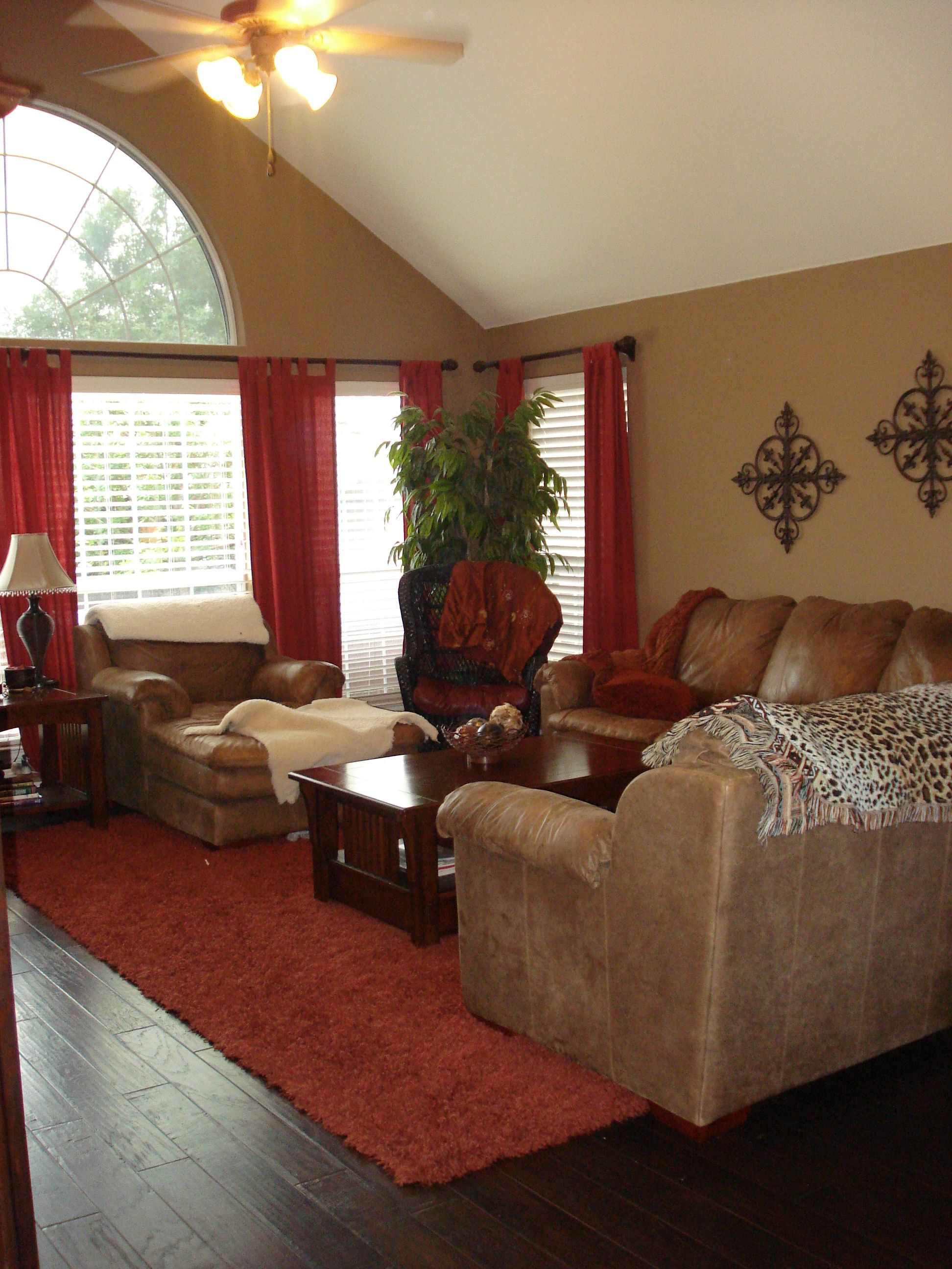 Warm family room red 39 s and browns for the home for What color curtains go with beige walls and dark furniture