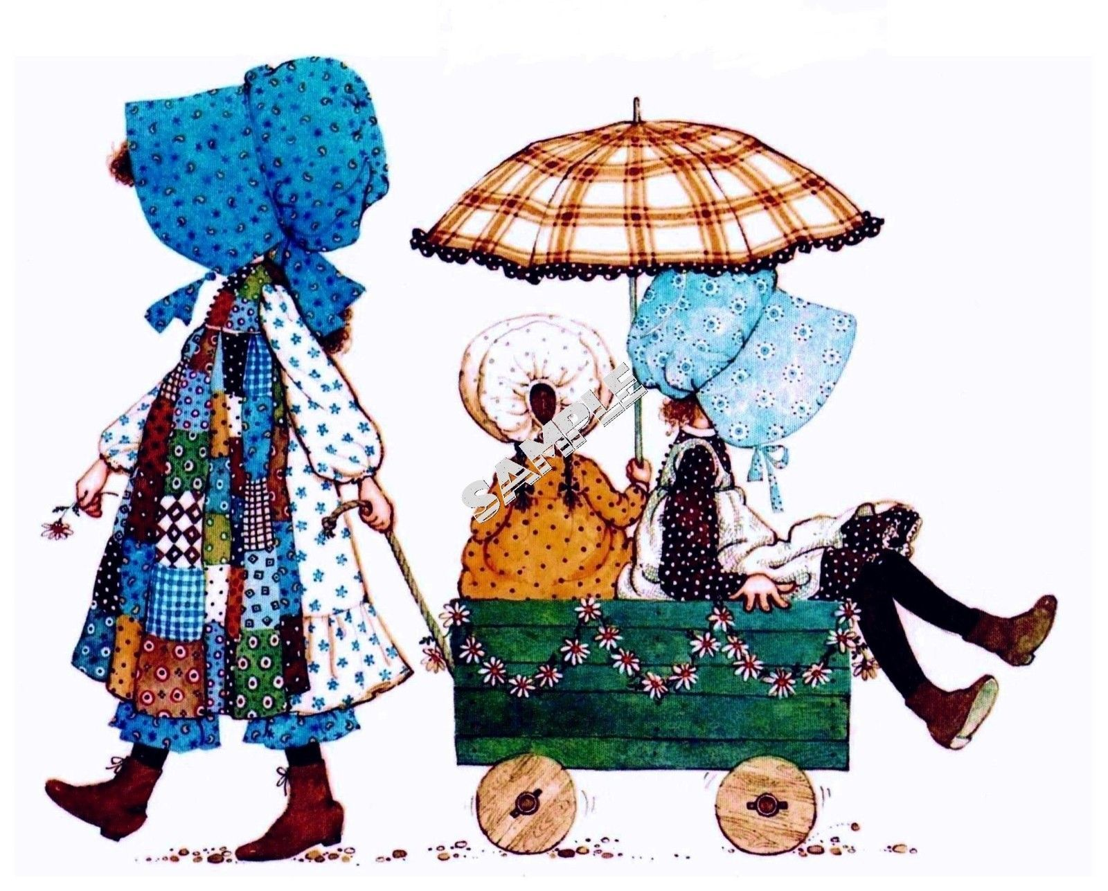 Holly Hobbie pulling her friends in a wagon.