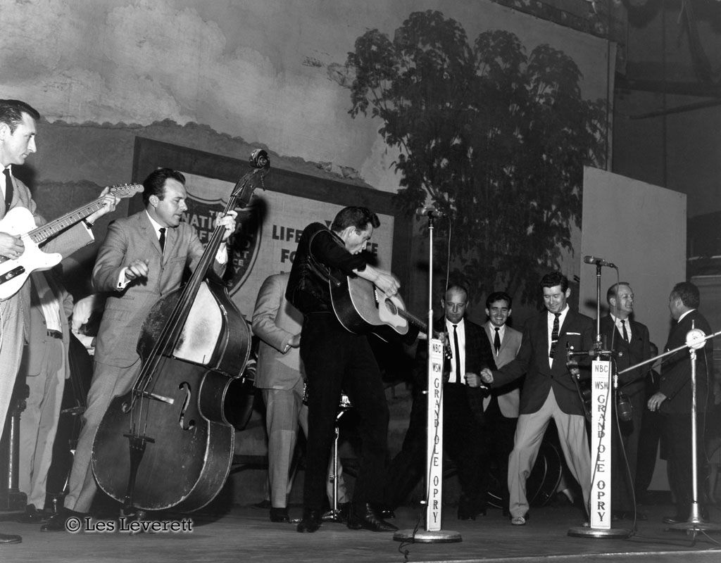 Johnny Cash on stage at the Ryman on 3/23/1963 with Carl Perkins ...