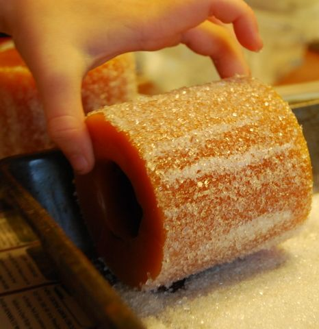 Roll pillar candles in Mod Podge then roll in Epsom salt for a pretty, snowy look during the holidays!