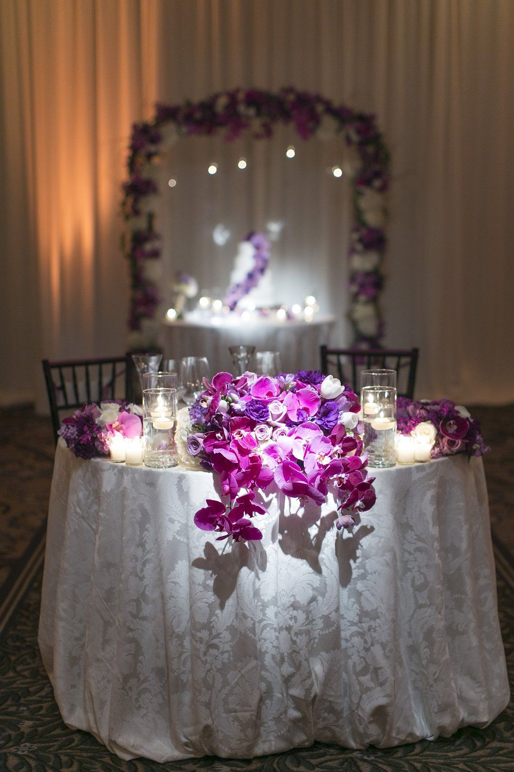Sweetheart Table wedding centerpiece. Purple orchids ...