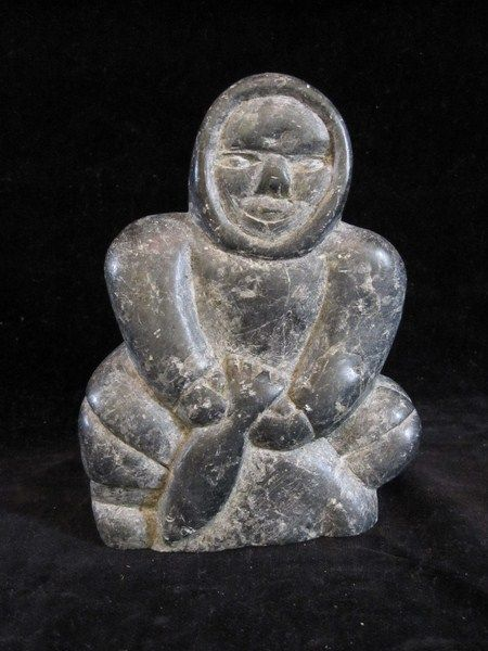Vintage inuit soapstone carving depicting an